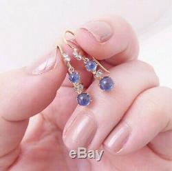 18ct gold cabochon sapphire rose cut diamond earrings
