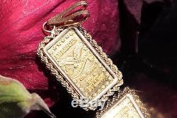 American one gram. 999 fine gold bullion bar pendant 14k yellow gold bezel 1.8gr