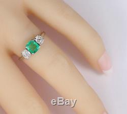 Antique Platinum Emerald and Mine Cut Diamond Ring