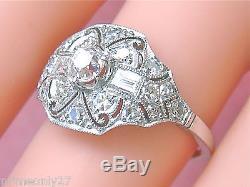 ESTATE ART DECO 1.02ctw MINE & BAGUETTE DIAMOND PLATINUM COCKTAIL RING