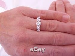 Exceptional 18 carat gold 1 3/4 carat old mined cut diamond 5 stone ring