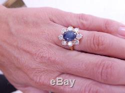 Large sapphire & 1.2 carat diamond cluster 18 carat gold ring