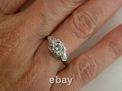 Vintage Diamond Engagement Ring. 65ct Platinum Cushion Cut Antique Art Deco
